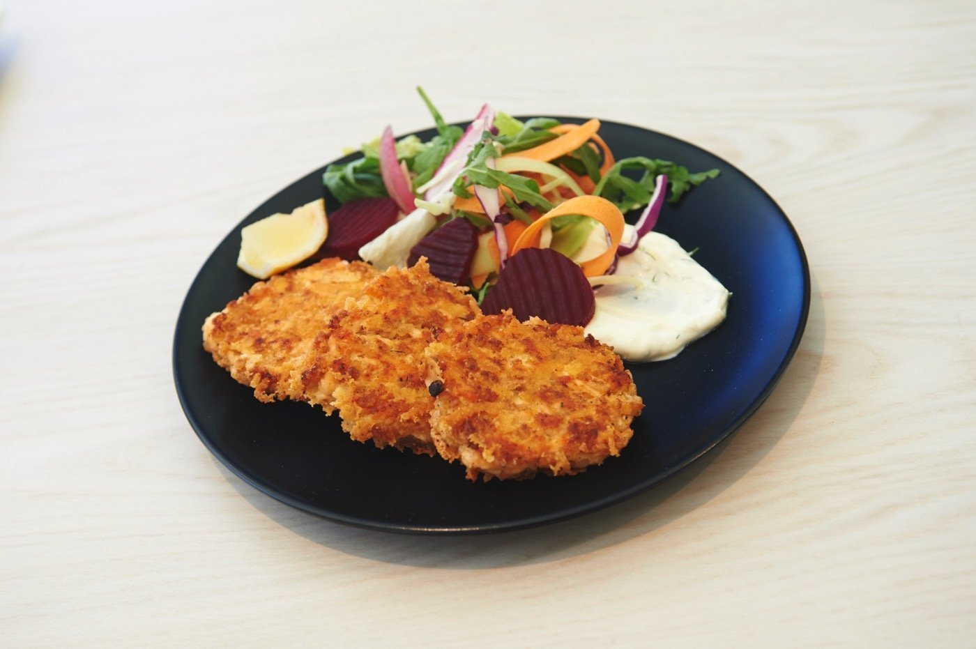 Salmon croquettes with parmesan and salad