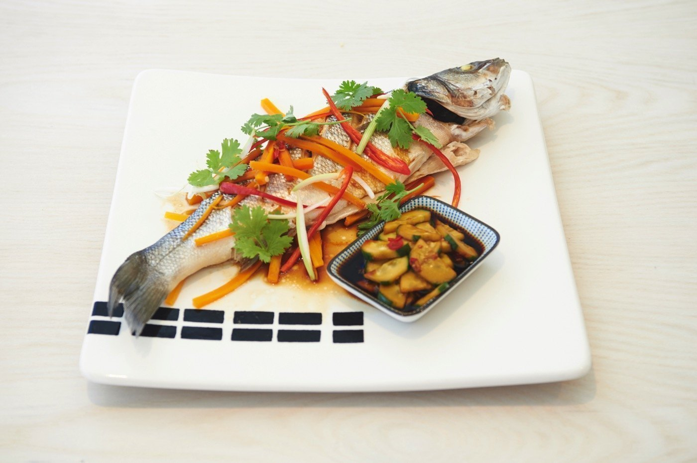 Steamed sea bass with soy sauce, ginger and spring onions
