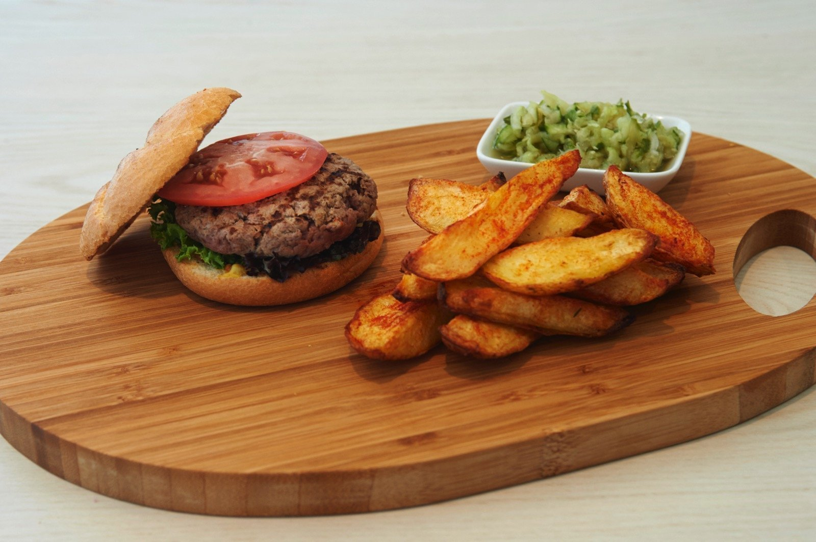 Mini Burgers filled with cheese *served with crunchy paprika potato wedges and a cucumber relish