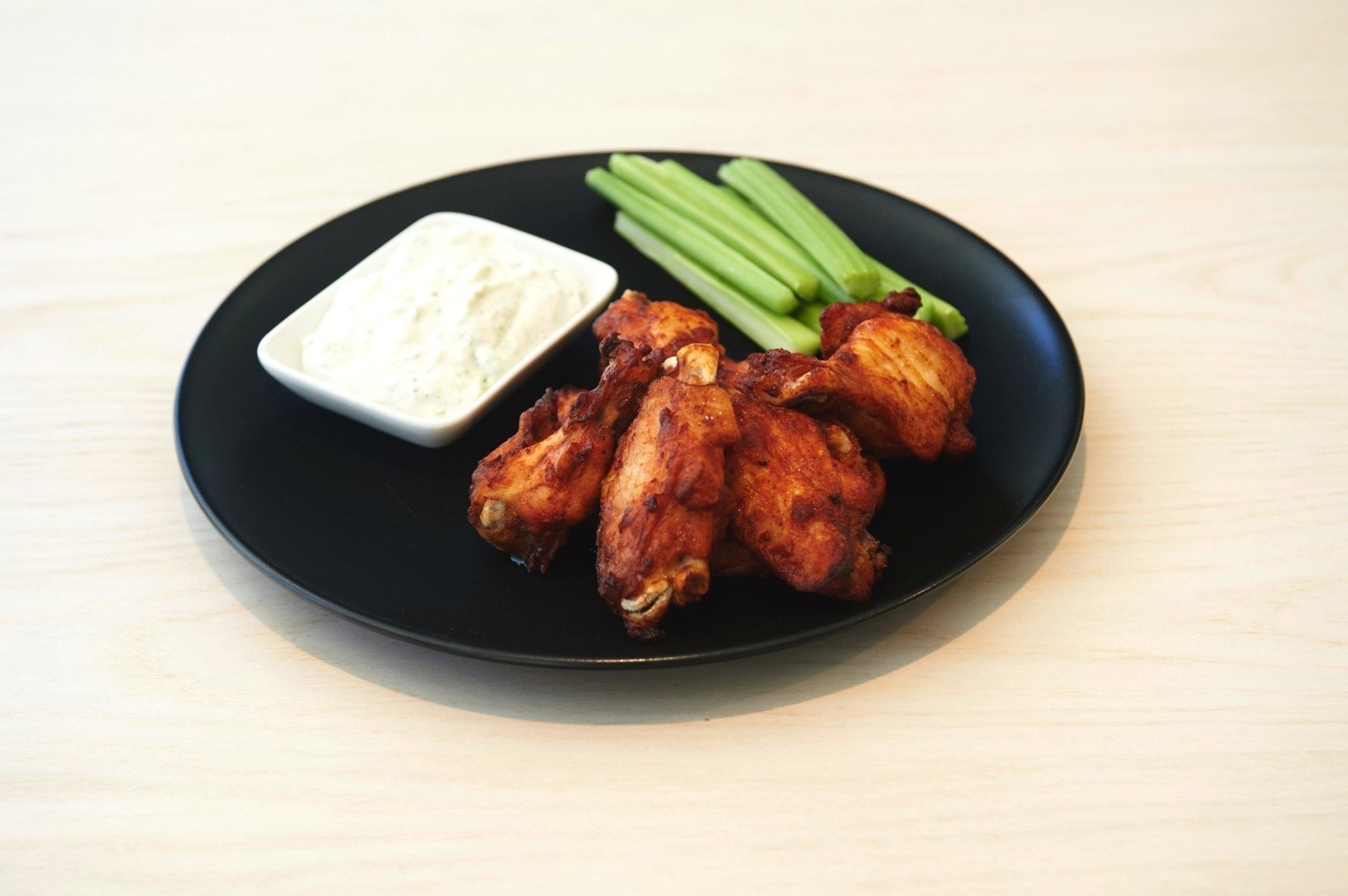 Mexican chicken wings with blue cheese sauce with yoghurt and honey