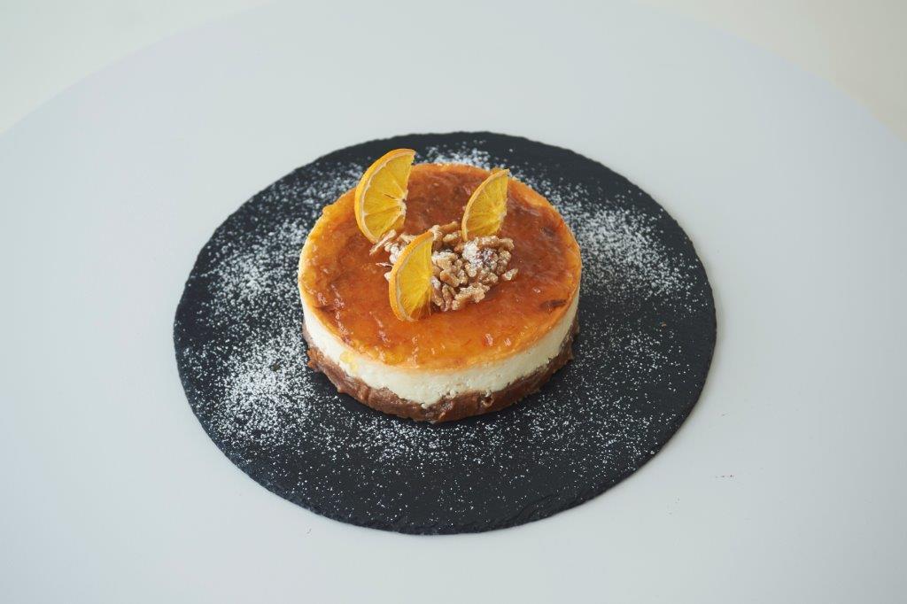 Cheesecake με μελομακάρονα και κλημεντίνη.